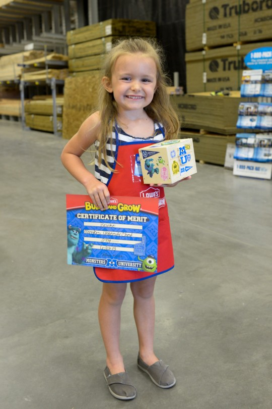 Brooke with her certificate and finished Monster's University chest!