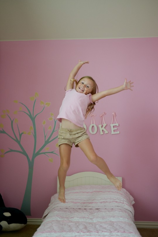 This girl loves jumping on beds!