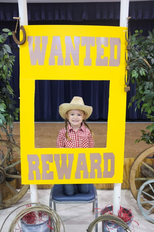 Brooke with the WANTED sign I made for Western day!