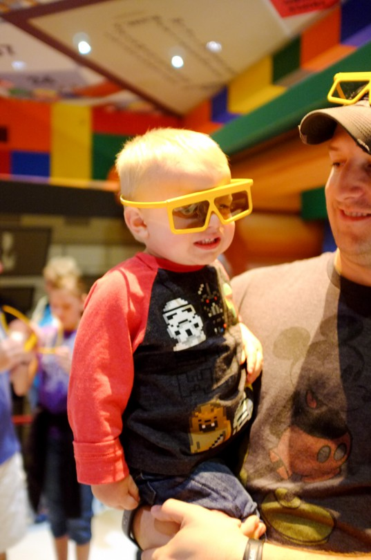 Getting his glasses on to ride Toy Story Mania!