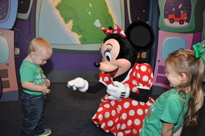 Showing Minnie that Mickey was on his shirt!