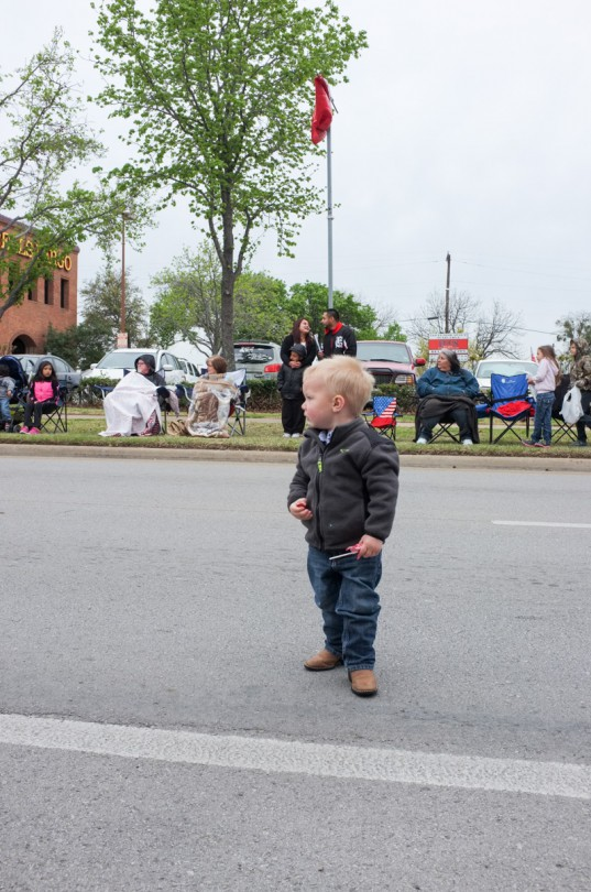 Standing in the street waiting for the next people! He was loving the parade!