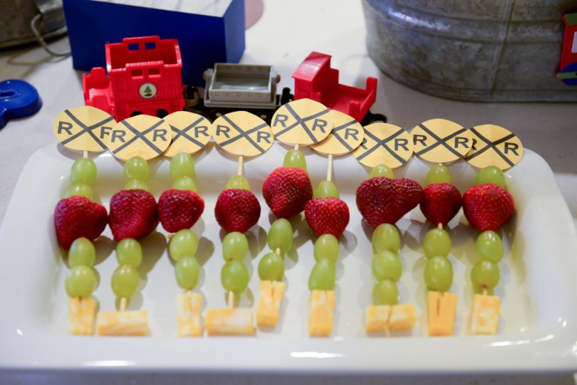Fruit sticks with railroad crossing signs on the top!